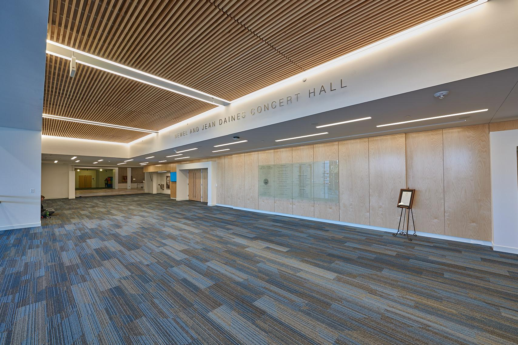 Main entrances to the Daines Concert Hall are located up the stairs from the Hansen Atrium, west of the Rock Lobby.