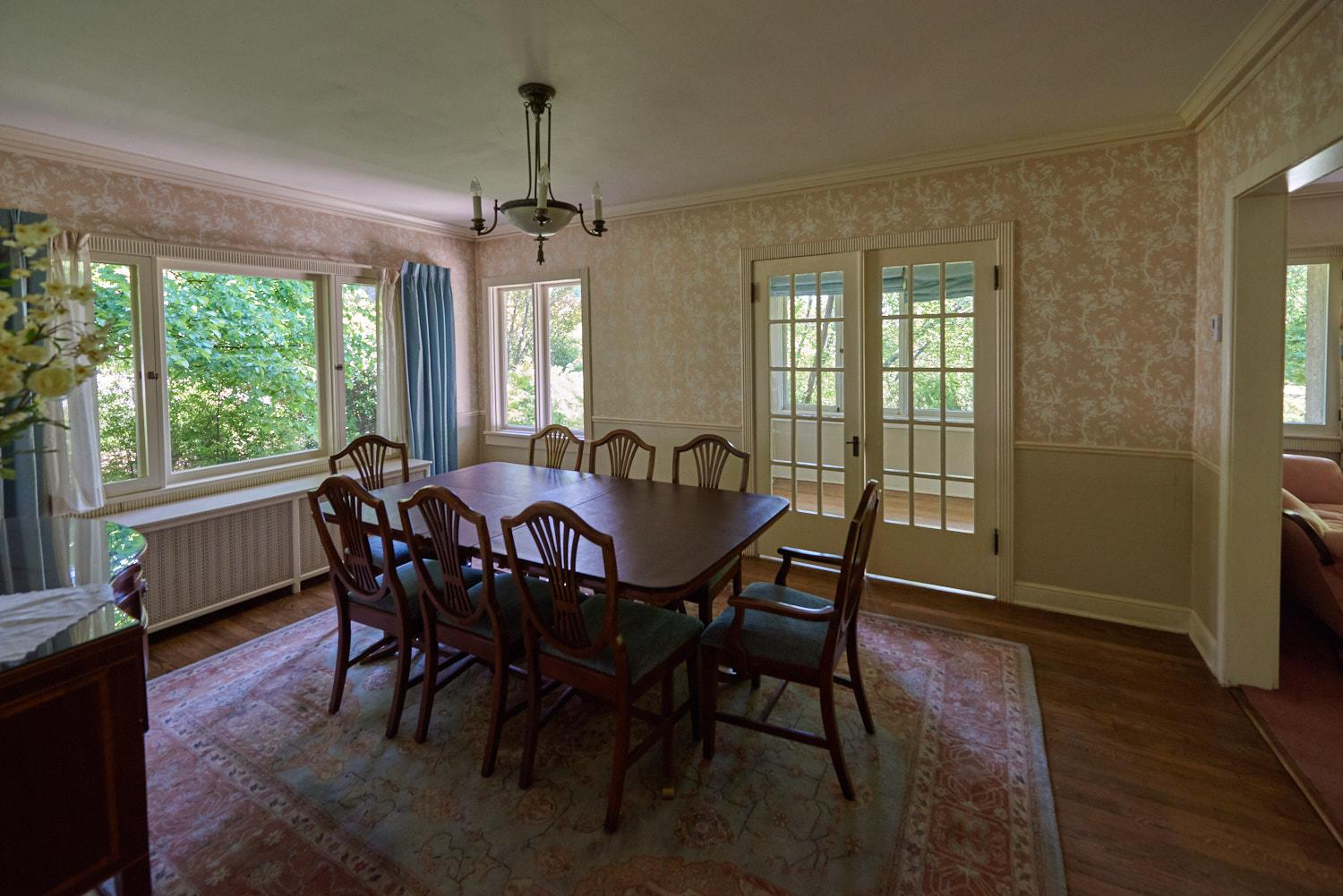 The Caine Home dining area has french doors which lead to a balcony patio.