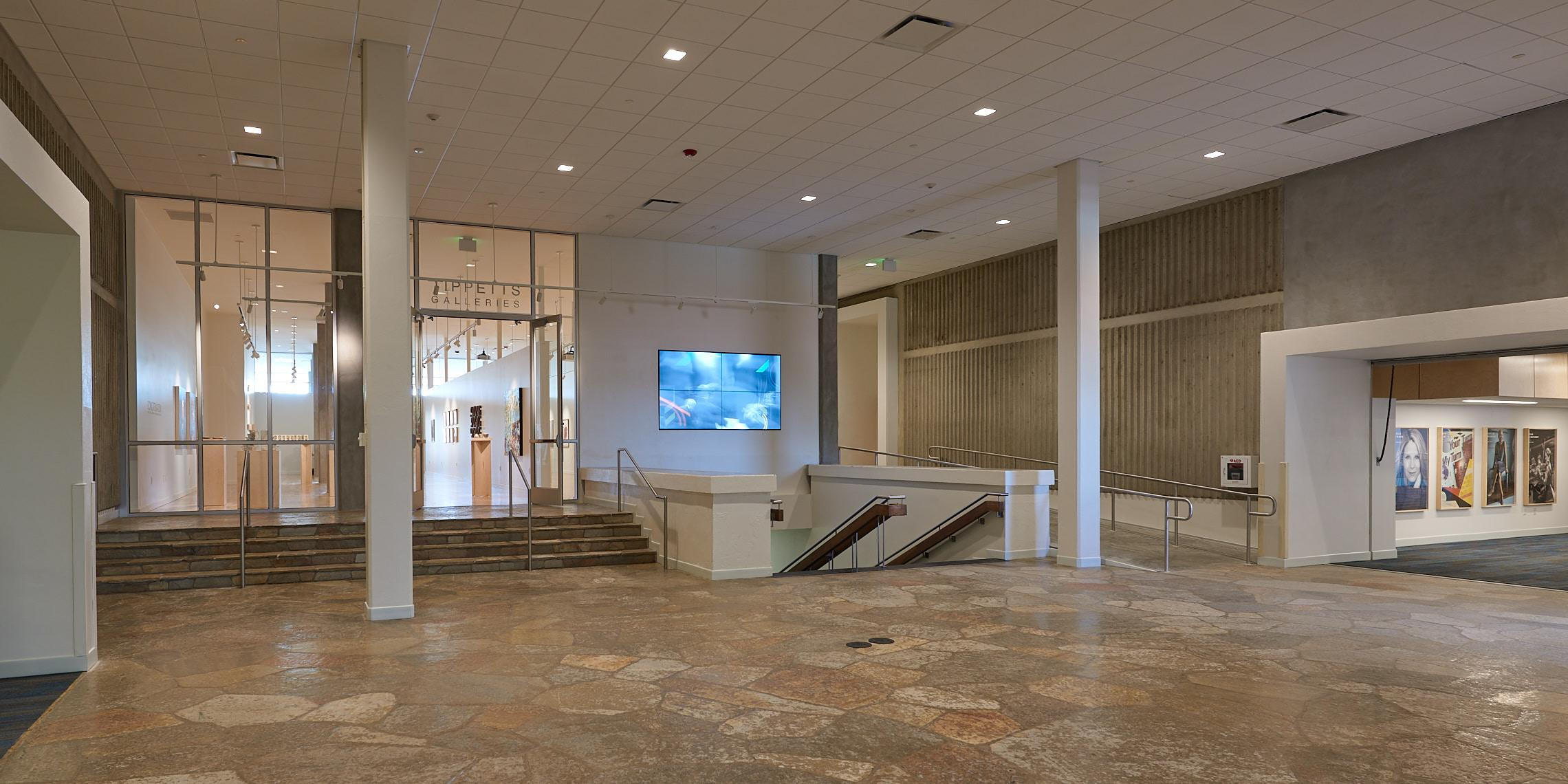 The entrance to The Galleries is located on the south side of The Rock Lobby in the Chase Fine Arts Center.