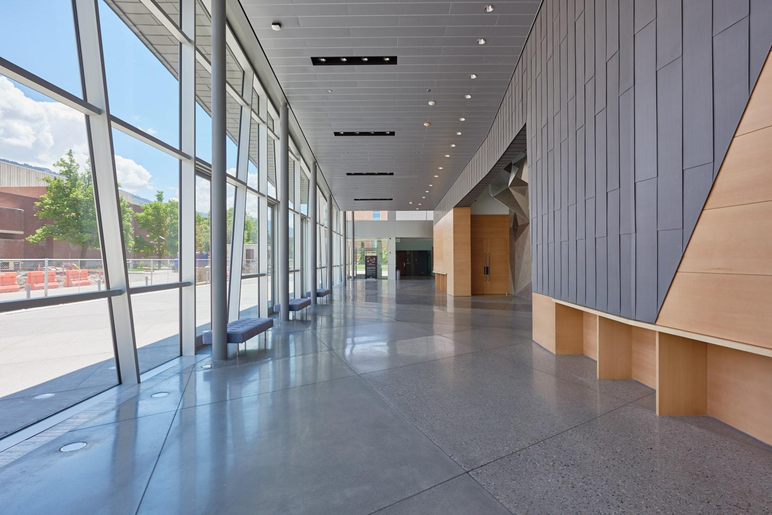Glass windows overlook a plaza to the east of the Performance Hall.